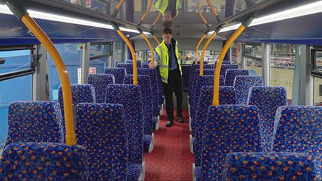 Presenter inspecting bus